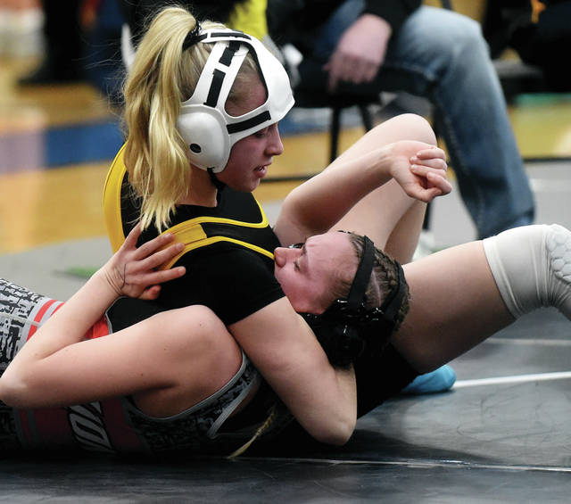 Sidney sophomore Josie Davis pins her opponent in a quarterfinal match of the Ohio High School Wrestling Coaches Association's girls state tournament on Saturday at Hilliard-Davidson High School. Davis finished first in the 121-pound weight class. It's the second year she's won an individual state title.