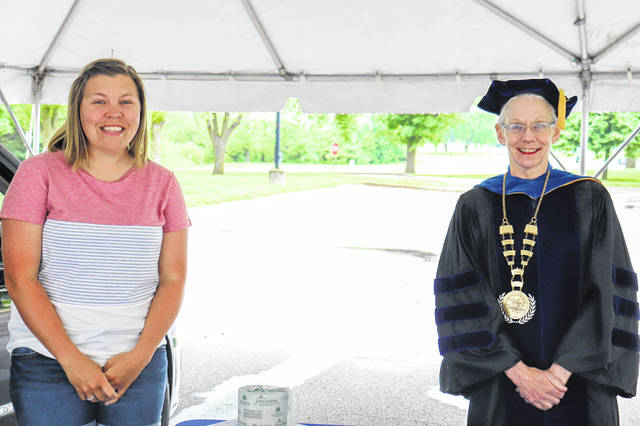 Holly Middendorf, of Fort Loramie, poses with President Dr. Doreen Larson during Edison State Community College's drive-through diploma pick-up after graduating with an Associate of Applied Science degree in Early Childhood Education.