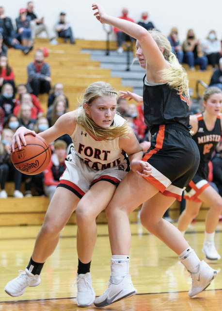 Fort Loramie senior forward Dana Rose dribbles around Minster's Ella Mescher during the first half of a nonconference game on Saturday in Fort Loramie. The Redskins were voted the No. 1 seed in the Sidney Div. IV sectional while the Wildcats were voted the No. 1 seed in the Wapakoneta Div. IV district.
