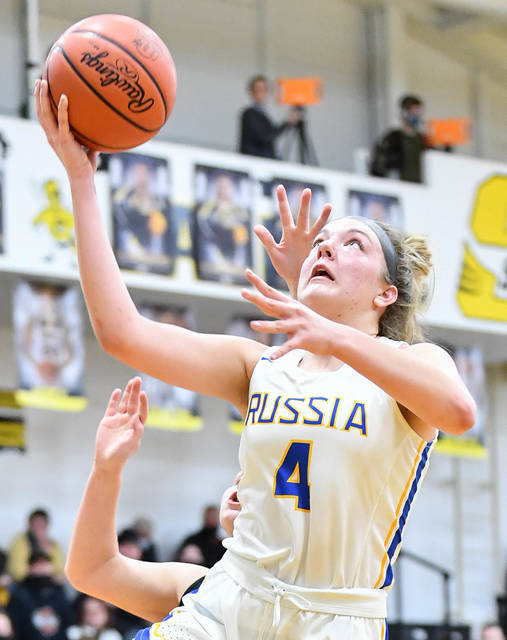 Russia sophomore forward Kate Sherman shoots with pressure from Botkins' Aleah Johnson during a Division IV district semifinal on Monday at Sidney High School. Sherman led the Raiders with 13 points.