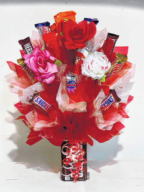 "Giving ""candy"" bouquets can be a delicious alternative, like this one from Candy Bouquet, located at 523 S. Broadway in downtown Greenville. Customized assortments can include chocolates, gummies, taffy, home-dipped novelties, like sweet savory and chocolate-covered bacon."