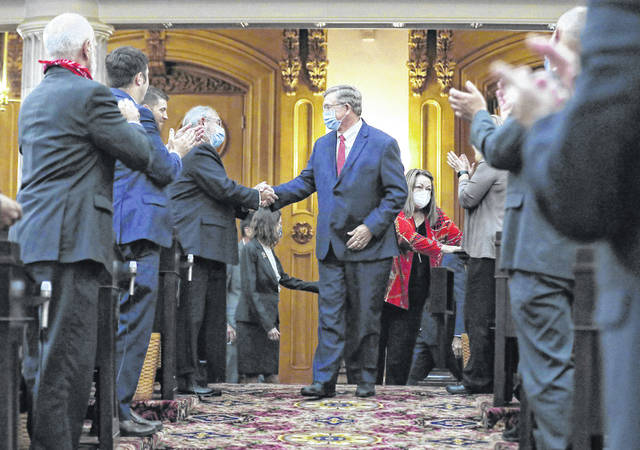 Bob Cupp, R-Lima, center, is congratulated after being elected Speaker of the House at the Ohio Statehouse on Thursday, July 30. [Fred Squillante/Dispatch]
