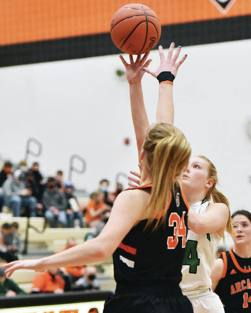 Anna's Breann Reaman shoots as Arcanum's Taylor Gray defends during a Division III district semifinal against Arcanum on Monday in Versailles. Reaman scored 22 points and had eight rebounds.