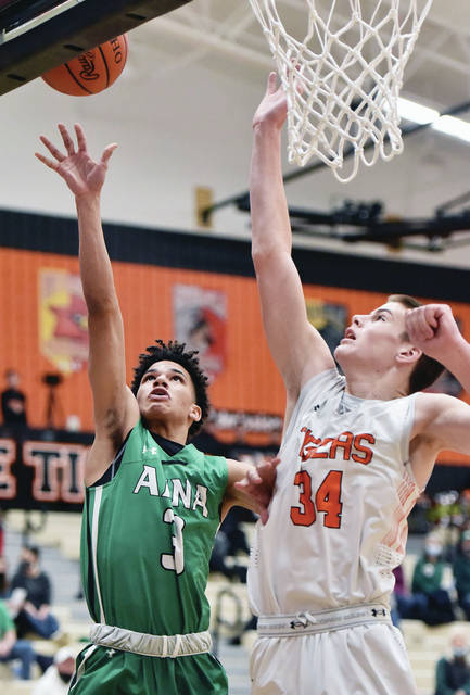 Anna senior guard Isaiah Masteller shoots as Versailles' Connor Stonebraker tries to block during a nonconference game on Tuesday in Versailles. Masteller scored 19 points while Stonebraker also scored 19 points.
