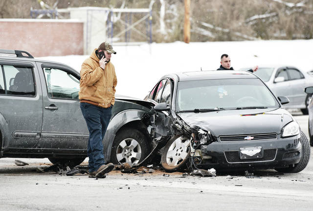 A Nissan Pathfinder SUV, left, collided with the side of a Chevy car at the intersection of Fourth Avenue and West Court Street at around 3:15 p.m. on Thursday, Feb. 4. The Sidney Police Department and Sidney Fire Department responded to the scene.