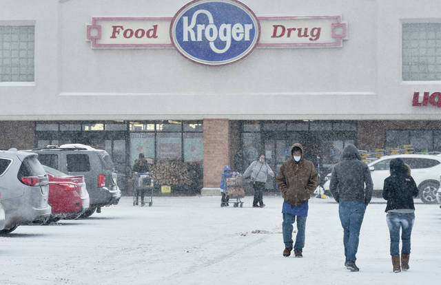 People run out to Kroger for last minute provisions as snow falls Monday, Feb. 15 around 3 p.m..