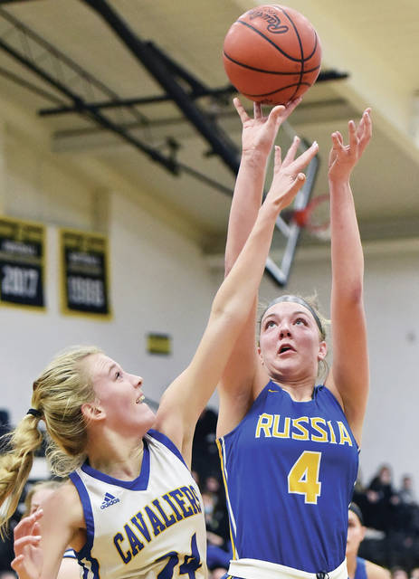 Russia's Kate Sherman shoots as Lehman Catholic's Heidi Toner defends during a Division IV sectional final on Wednesday in Sidney.