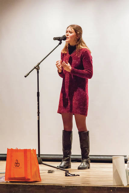 Lexi Gastelu, of Piqua, performs poems by George Marion McClellan and Carolyn Wells at the 2021 Poetry Out Loud competition, held at Edison State Community College.