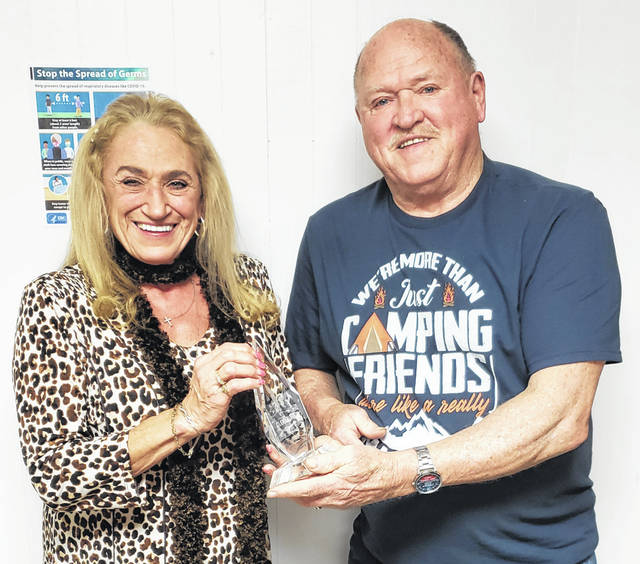 Eagles Lodge Secretary Connie Westover, of Sidney, presents the Volunteer of the Year Award award to Glenn York, also of Sidney.