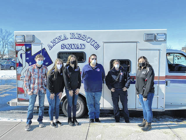 Jackson Center FCCLA Members Ross Ludwig, Morgan Kipker, Kieran Yarkosky and Carleigh Ross pose with Anna Rescue members Pamela Knapke and David Klopfenstein during a meal held for Shelby County first responders on Feb. 3 at Jackson Center Local Schools. Local first responders were treated to a drive thru pick up lunch consisting of chicken tetrazzini, roll, green beans and cookie. Approximately 118 meals were served.