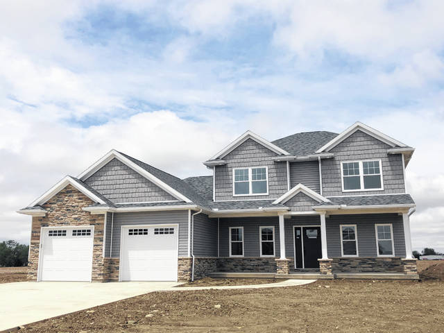 This is an exterior photograph of a home completed by Middendorf Builders at 112 Timbeer Trail in the Timber Trails Subdivision.
