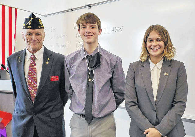 John McJunkin, District Oratorical chairman is shown with Tyler Rowen, a freshman at Parkway High School, and Liberty Menke, a senior at New Knoxville High School.