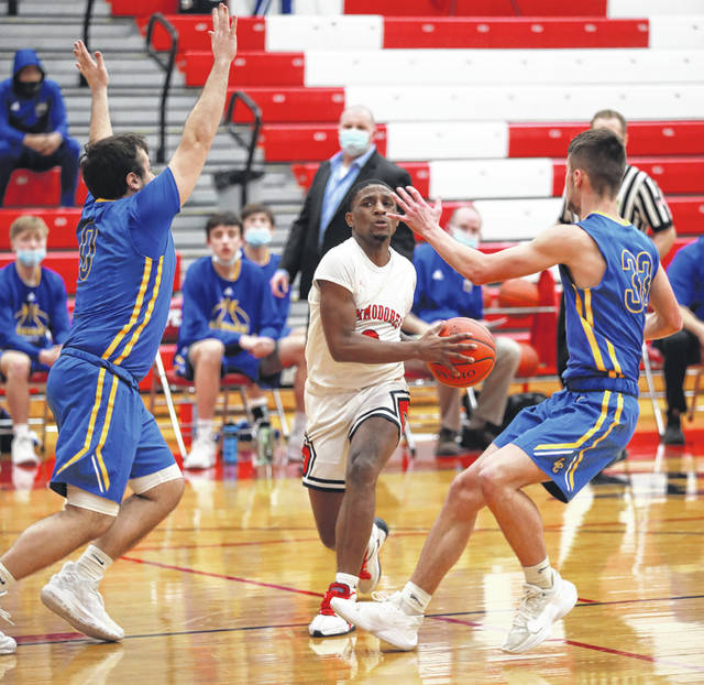 """Lehman Catholic's Luke Frantz, left, guards Lima Perry's Brayden """"Bubby"""" Knight as he drives during a Northwest Central Conference game in Lima. The Cavaliers lost 46-32."""