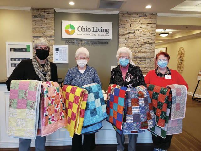 """""""The Knotters"""" quilting club of Ohio Living Dorothy Love in Sidney recently donated their handmade quilts to Wilson Health's Hospice. The quilts will be given to new hospice patients. Pictured accepting the quilts, from left to right, is Wilson Health Chaplain Angela Barfield; Ohio Living Dorothy Love Residents Barb and Margaret of The Knotters Quilt Club; and Lori Puterbaugh, Independent Living Activities Coordinator."""