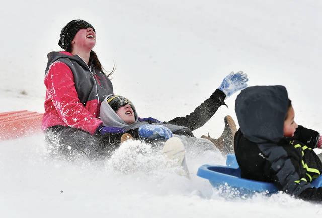 Lauren Conley, left to right, 15, and Tucker Herron, 14, collide with Kingston Fout, 8, all of Sidney, after going over a bump that dislodged them from their sled on a hill at the Moose Golf Course on Monday, Feb. 1.The hill was packed with sledders for the second day in a row. Lauren is the daughter of Dana and Matt Conley, Tucker is the son of Jimmy and Ashley Herron, and Kingston is the son of Stephanie and James Fout.