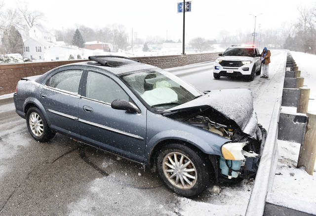 A car crashed on West Court Street in the Eastbound lanes next to the Highland Avenue overpass around 4 p.m.. Traffic onto that section of West Court Street was blocked off at its Fourth Avenue intersection. Sidney police are investigating.