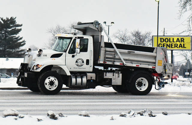 A City of Sidney truck puts down salt as it drives along St. Marys Avenue on Wednesday, Feb. 10. A small amount of snow that started Wednesday and continued into the early hours of Thursday made for some slick spots and contributed to some car accidents.
