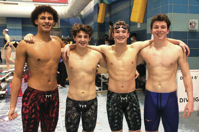 Sidney's Jahvon Lloyd, Jarrett Payne, Badin Brewer and Jaden Humphrey pose for a photograph after setting program records in 200 Medley Relay and 400 Freestyle Relay in a meet earlier this season.