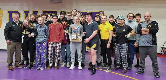 Sidney wrestlers and coaches pose with the Miami Valley League Valley Division trophy after securing a divisional title earlier this month. The Yellow Jackets finished third overall out of 10 MVL teams. Vandalia-Butler earned the overall MVL title.