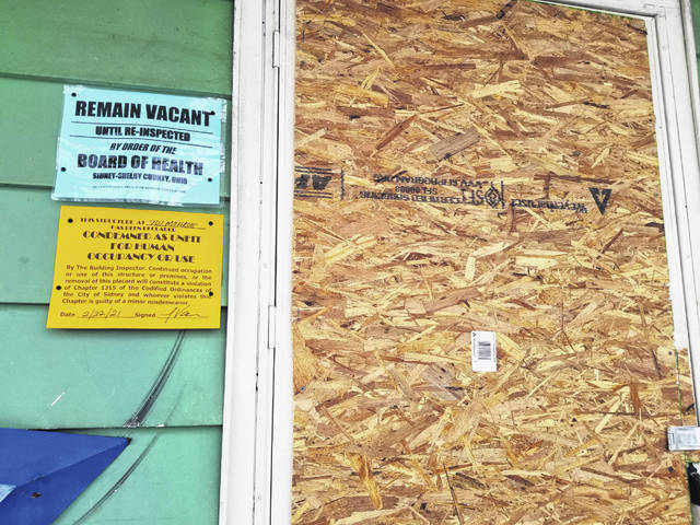 A door is boarded up at the residence of 701 Monroe St. which was condemned Monday, Feb. 22, due to a continued pattern of drug abuse behavior, specifically drug usage, drug trafficking and drug overdoses.