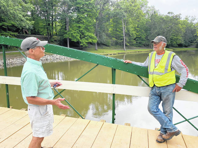 Ohio Bridge Association President David Simmons talks with retired Auglaize County Bridge Engineer Dan Bennett about the importance of saving the last remaining known example of a Zenas King bow string bridge in Ohio. The bridge was relocated to Tawawa Park.