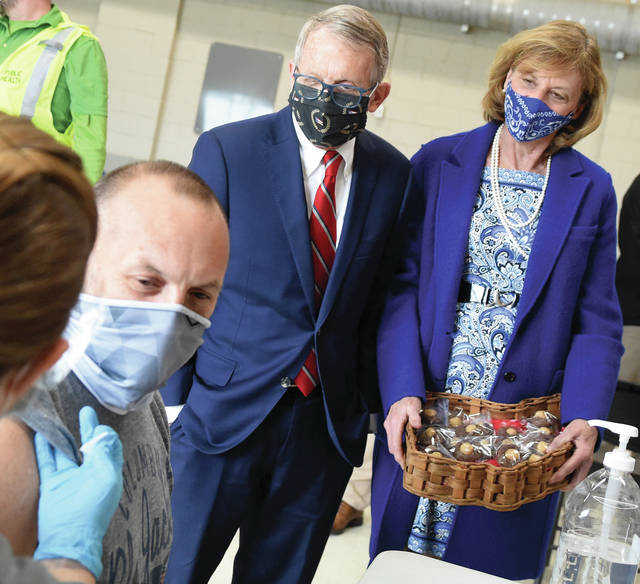 Gov. Mike DeWine and Ohio's First Lady Fran DeWine look on as Piqua resident Barry Gertner receives a COVID-19 vaccination at a Saturday morning clinic held at Mote Park.