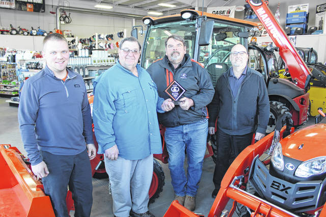 Apple Farm Service earned Elite Status for 2020 with Kubota. Pictured are, left to right, Brent Diller, Kubota regional service manager; Bill Apple, Apple Farm Service president and CEO; Jerry Snapp, Kubota sales specialist; and Bruce Williams, Kubota regional territory manager.