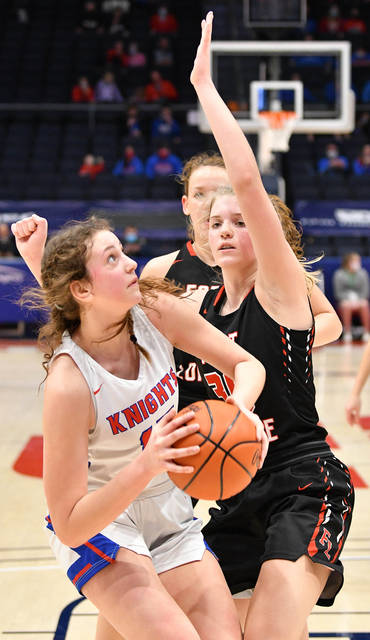 Convoy Crestview's Myla Etzler shoots with pressure from Fort Loramie's Dana Rose during the first half of a Division IV state semifinal on Thursday at University of Dayton Arena. Rose led the Redskins with 22 points.