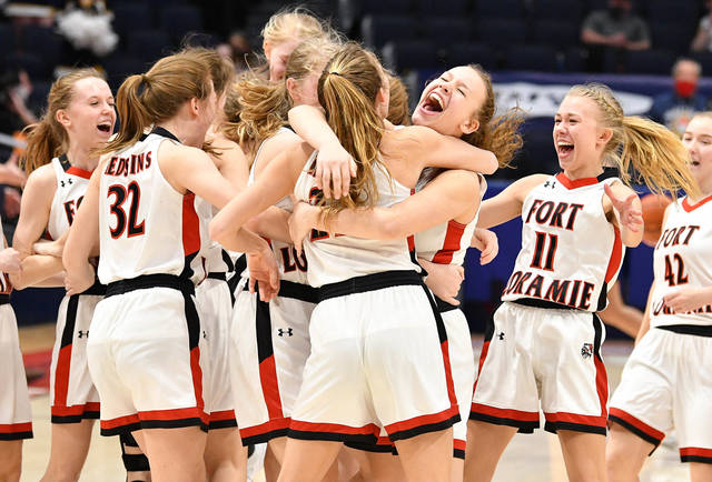 Fort Loramie players celebrate after beating McDonald 60-26 in the Division IV state championship game on Saturday at University of Dayton Arena.