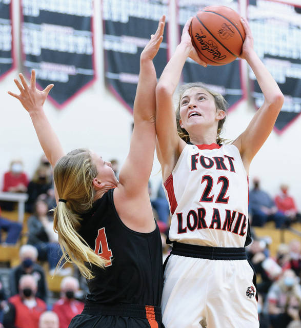 Fort Loramie senior forward Kenzie Hoelscher shoots over Minster's Ivy Wolf during the first half of a nonconference game on Dec. 12 in Fort Loramie. Hoelscher was named first team all-Southwest district in Division IV after averaging 13.8 points, five rebounds and 3.5 steals per game.