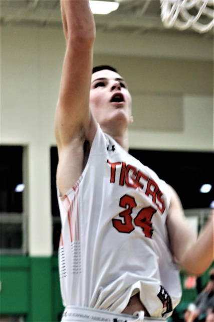 Versailles' Connor Stonebraker shoots during a Division III district semifinal against Preble Shawnee on Saturday at Northmont High School's Thunderdome.