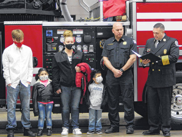 Civilian Isaiah Linton, left, was presented a Life Saver Award, with his two siblings and mother by his side, with Assistant Chief Eric Barhorst, second to right, and Fire Chief Chad Hollinger, far right, for his actions on March 27, 2020. A fire broke out in an upstairs bedroom of their home and Isaiah quickly helped his siblings escape the fire while his mother was out on a quick trip to the grocery store. Awards for selfless and extraordinary acts were given out during a ceremony at Sidney Fire Station 1 on March 11.