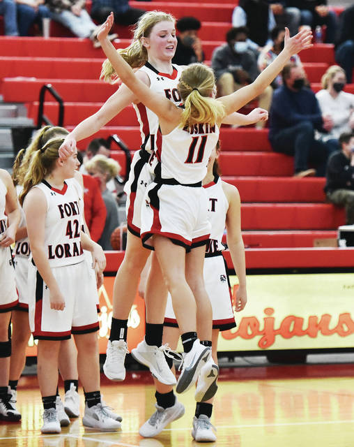 Fort Loramie's Dana Rose and Caitlyn Gasson celebrate after defeating Cincinnati Country Day in a Division IV district final on Saturday at Troy High School's Trojan Activities Center.