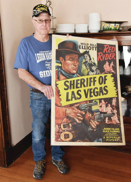 """Cecil Steele, of Sidney, holds The movie poster he kept from when he worked at the Checkers Theater in Sidney as a teenager. The poster promotes Red Ryder played by Wild Bill Elliott in the movie """"Sheriff of Las Vegas."""""""