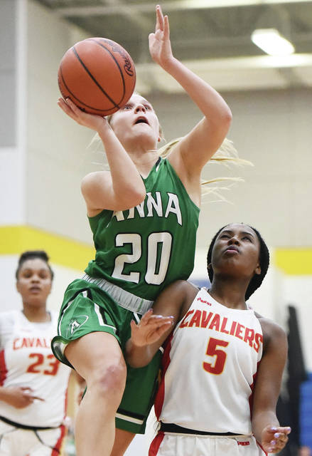 Anna's Ella Doseck shoots as Cincinnati Purcell Marian's Leah Smith defends during a Division III regional semifinal on Wednesday at Springfield High School. Doseck reached 1,000 career points in the squad's 49-44 loss.