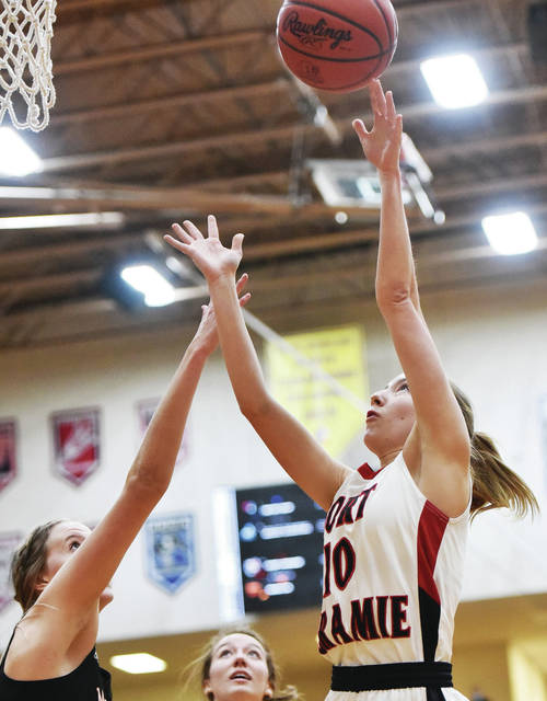 Fort Loramie's Colleen Brandewie shoots as Minster's Brynn Oldies defends during a Division IV regional semifinal on Thursday at Vandalia-Butler's Student Activities Center.