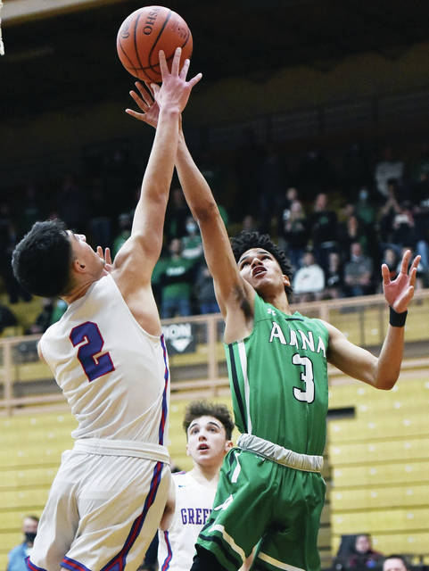 Anna's Isaiah Masteller shoots as Greeneview's Cole Allen defends during a Division III district final on Friday at Vandalia-Butler's Student Activity Center. Masteller scored 21 points.