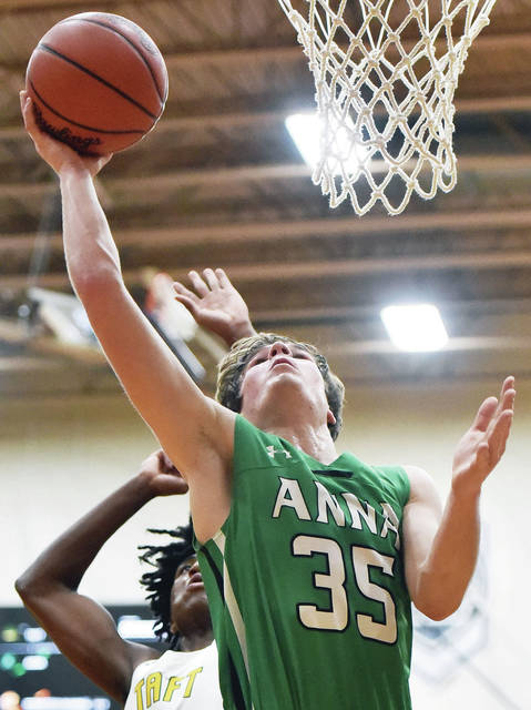 Anna senior forward Ben Kovacs shoots with pressure from Cincinnati Taft defenders during a Division III regional semifinal on Wednesday at Vandalia-Butler's Student Activity Center. Kovacs scored 17 points.