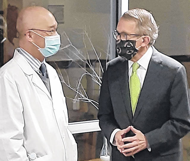 Ohio Gov. Mike DeWine, speaking with Dr. Henry Chong, left, was in Greenville Saturday, overseeing COVID-19 vaccinations being dispensed at Reid Hospital's Greenville offices. DeWine said approximately 17 percent of Darke County residents have thus far received a vaccine.