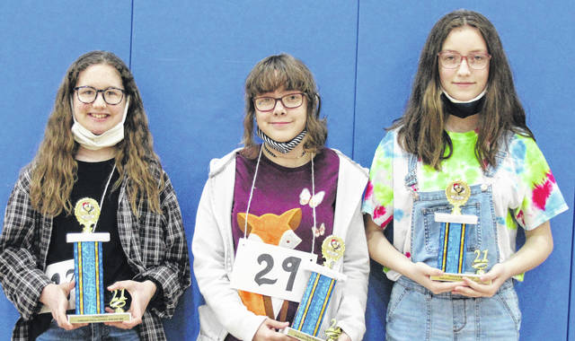 On March 18, Fairlawn held its annual spelling bee. Twenty-eight students in grades three through eight competed after making it out of their grade level bees. After 11 rounds, seventh-grader Alli Orsborne, left, daughter of Neil and Alysha Orsborne, won by spelling the word goblins. Eighth-grader Lilian Berryman, center, daughter of Ben and Sulachena Berryman, was the first runner up and sixth-grader, right, Sarah Patten, daughter of Don and Megan Patten, was the second runner up.