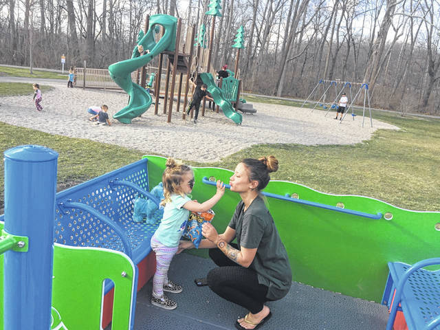 Aria Gross, 2, plays with her mom Taylor Gross, of Sidney, Wednesday evening, March 24, at the All Inclusive Park at Tawawa Park.