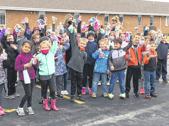 Kindergarteners and first graders from Versailles Elementary School participated in an Easter egg hunt on Friday, March 26, 2021, at Versailles Rehabilitation and Healthcare Center. Residents of the skilled nursing facility hid the candy-filled eggs that were filled by a local 4-H club.
