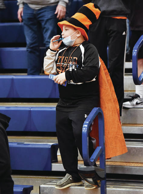 No. 1 Jackson Center boys basketball fan Braxton Roberts, 9, of Jackson Center, son of Dan and Shannon Roberts, blows a kazoo after Jackson Center defeated Russia in Division IV District Semifinal at Piqua High School on Saturday, Feb. 28.