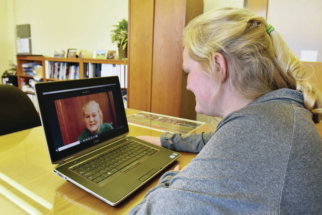 Lehman Catholic High School student Emma Keykens watches herself on a video she made as it plays during a conference call. Keykens made the video to enter the Multimedia portion of the 2021 Dr. Martin Luther King, Jr. Art, Essay and Multimedia Contest.