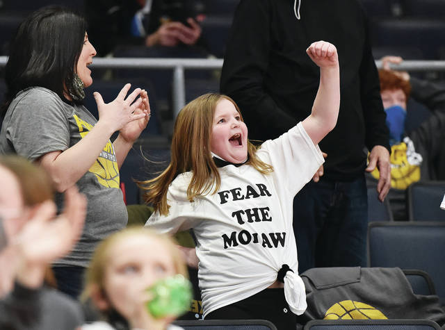 Carleigh Groves, right, 8, pumps her fist in the air after the Botkins Trojans defeated Richmond Heights in a Division IV state semifinal game at the University of Dayton Arena on Friday, March 19. With Carleigh is her mom, Erin Groves, both of Sidney. Carleigh's dad, Phil Groves is the Botkins varsity girls basketball coach. Botkins will head back to Dayton Sunday for the state final.