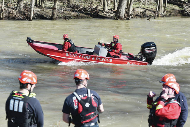Sidney Firefighters Jeff Simon, left in boat, and Scott Marchal, head up stream in a rescue boat on the Great Miami River. The Sidney Fire Department was using Roadside Park as a staging area for water rescue training on Wednesday, March 3.