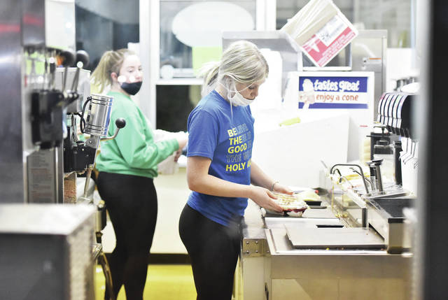 Joyce Billing, right, makes a banana split at Chilly Jilly's as Abigail Nolan, both, of Anna, works with her. Chilly Jilly's opened for the season on Saturday, March 14.
