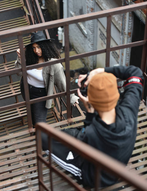 Kaija Steward, left, of Sidney, poses for photographer Antonio Hornung on escape stairs in an alley in downtown Sidney on Tuesday, March 16. Hornung spent the afternoon photographing Steward in different downtown locations to help build his photography portfolio.