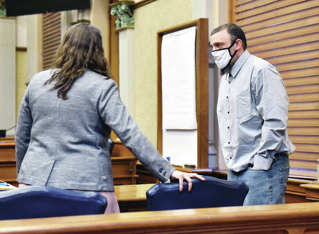 Defendant Joshua L. Scott, right, talks with his lawyer, Laura Waymire, during a break in his trial on Thursday, March 18. Scott was convicted of two counts of rape in Shelby County Common Pleas Court.