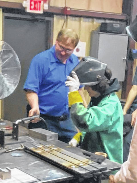 """John Bertsch, president and CEO of Detailed Machining, shared """"hands-on"""" opportunities with students who have expressed interest in a skilled trades career."""